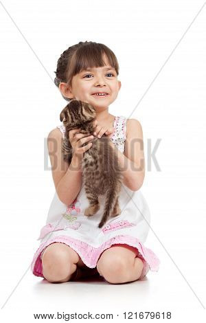 happy child gilr playing with cat kitten