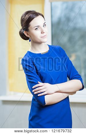 Natural Portrait Of Sensual Caucasian Brunette Woman In Stylish Official Blue Dress Posing Indoors