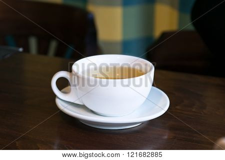 Breakfast Tea In A Cafe.cup On A Table