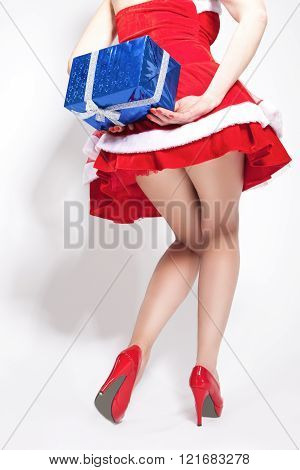 Closeup Of  Sexy Caucasian Female Legs. Model Holding Box Behind. Isolated On White.