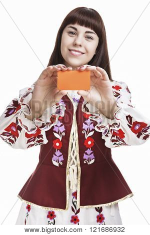 Young Caucasian Brunette Female Holding And Demonstrating Blank Card In Front . Against White.
