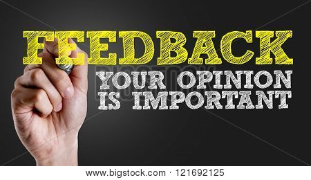 Hand writing the text: Feedback - Your Opinion Is Important poster