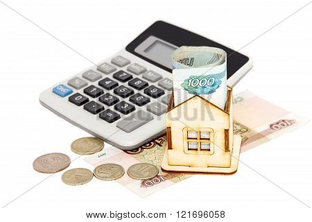 House, Money And Calculator On A White Background