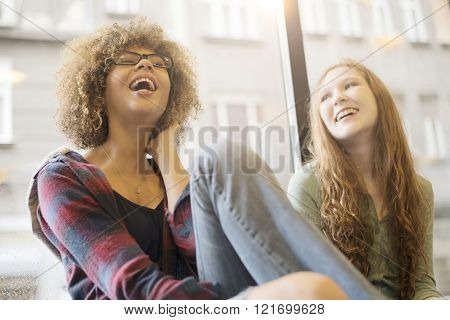 Two friends smiling together