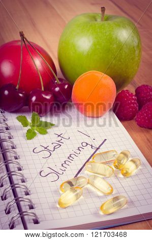 Vintage Photo, Fruits And Tablets Supplements With Notebook, Slimming And Healthy Food