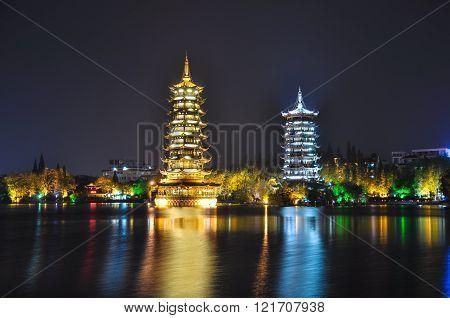 Guilin. Pagodas Of Sun And Moon At Night