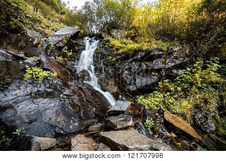 Beautiul Waterfall In A Forest At Autumn