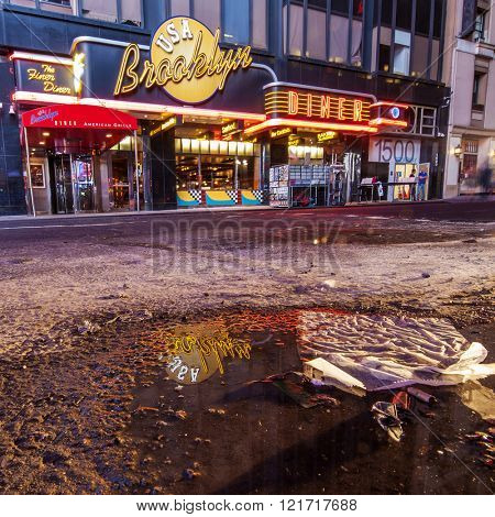 NEW YORK, NY, USA - June 12, 2015: Low angle of New York's busy 42nd Street off Times Square showing Brooklyn Diner.