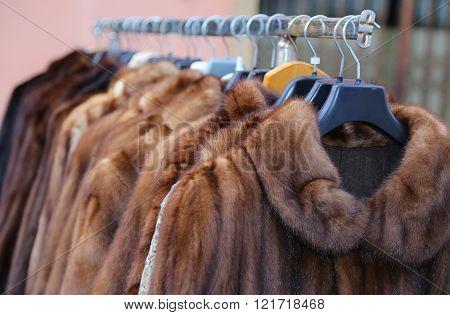 valuable fur coat for sale in the flea market poster