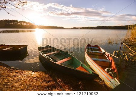 Boats At Sunset  By The Lake In Chiapas, Mexico