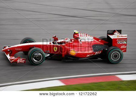 SEPANG - APRIL 4: Ferrari's Kimi Raikonnen practices at the 2009 F1 Petronas Malaysian Grand Prix on April 4, 2009 in Sepang, Malaysia.