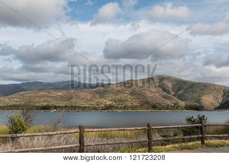 Mountain Range and Lake on Cloudy Day