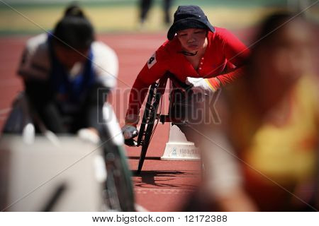 KUALA LUMPUR - AUGUST 16: Wheel chair athletes in action at the 800m race of the fifth ASEAN Para Games on August 16, 2009 in Kuala Lumpur.