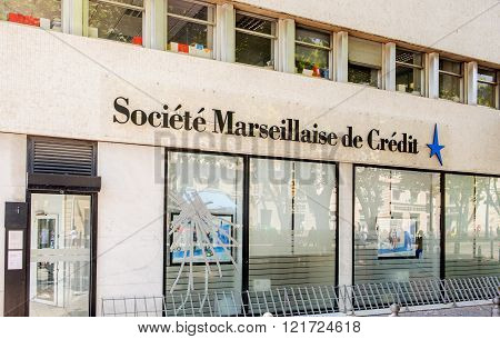 MARSEILLE FRANCE - JUL 18 2014: Headquarter of Societe Marseillaise de Credit bank with broken facade window.