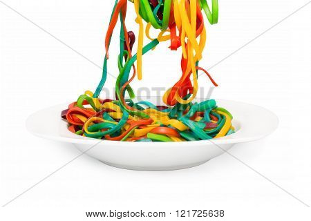 multicolored pasta in a white plate