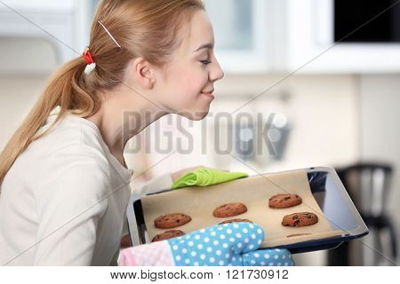Young enjoying the smell of a fresh baked cookies