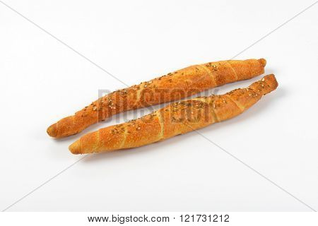 two salty long rolls on white background