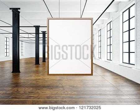 Photo of empty interior in modern loft. Open space loft.Empty white canvas hanging on the wood frame
