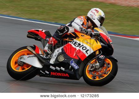 SEPANG - FEBRUARY 05: Andrea Dovizioso of the Repsol Honda team practices in the pre-season testing in preparation for the MotoGP championship. February 05, 2010 in Sepang, Malaysia.