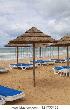 beach umbrellas at Algarve beach, Portugal