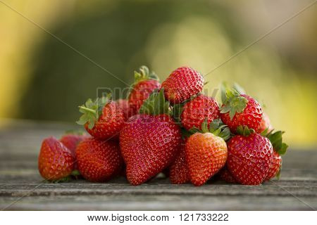 strawberries on garden's table, outdoor picture