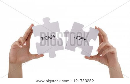 Puzzle pieces joining together to read  teamwork concept for unity, business team or partnership
