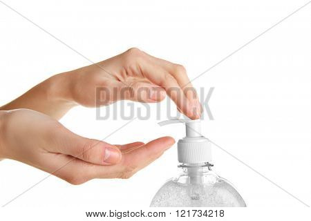 Female hands using liquid soap isolated on white