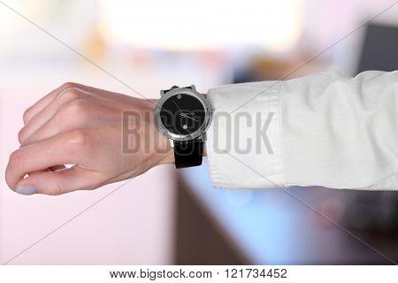 Modern watch on a businesswoman's hand, close up