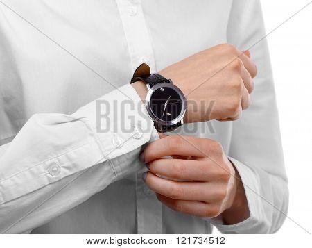 Modern watch on a woman's wrist, close up