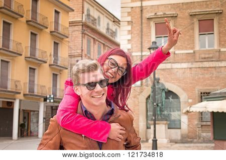 Young Couple Piggybacking in town