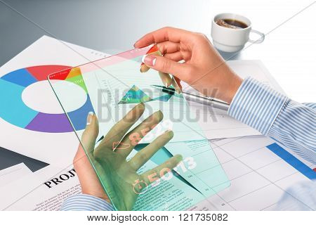 Female hands interacting with tablet.