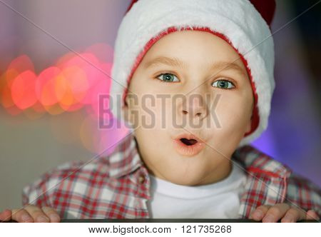 Portrait of cheerful boy in decorated room, close up