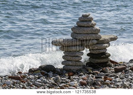 Inukshuk, Human made stone landmark for navigation or hunting grounds.