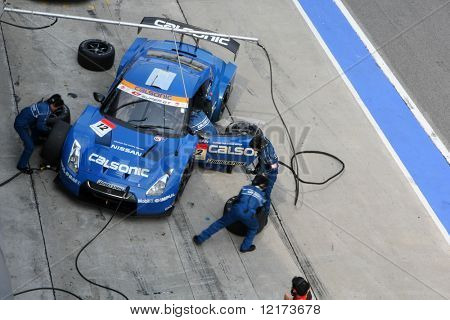SEPANG, MALAYSIA - JUNE 21: The Calsonic Impul GT-R Nissan car (12) pitting for tyre change at the Super GT International Series Round 4 race. June 21, 2010 in Sepang Malaysia.