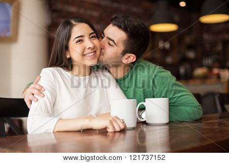 Good looking couple in a coffee shop