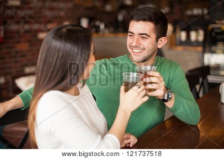 Young Couple Making A Toast With Beer