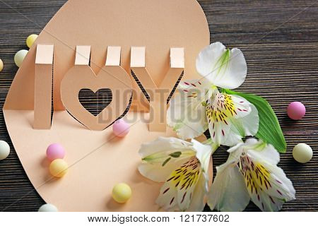 Valentine's Day concept. Beautiful gift card with flowers, close up