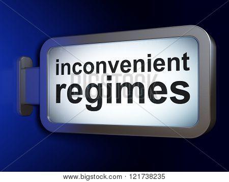 Political concept: Inconvenient Regimes on billboard background