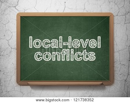 Politics concept: Local-level Conflicts on chalkboard background