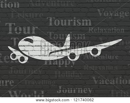 Vacation concept: Airplane on wall background