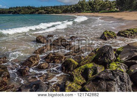 rocks and warm crystaline like waters of Maui