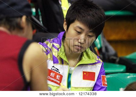 KUALA LUMPUR, MALAYSIA - SEPTEMBER 24: Guo Yue of China signs autograph for her fan at the Volkswagen 2010 Women's World Cup in table tennis on September 24, 2010 in Kuala Lumpur.