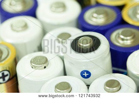 Pile of colorful batteries stacked in a row together