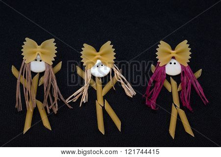 Pasta people girls.  Three girls dancing with bows on the heads