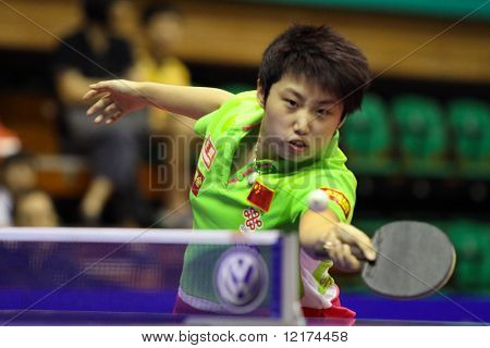 KUALA LUMPUR, MALAYSIA - SEPTEMBER 24: Guo Yue of China stretches to return the ball in her match during the Volkswagen 2010 Women's World Cup in table tennis on September 24, 2010 in Kuala Lumpur.