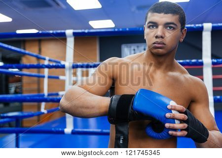 Handsome male boxer getting ready for fight
