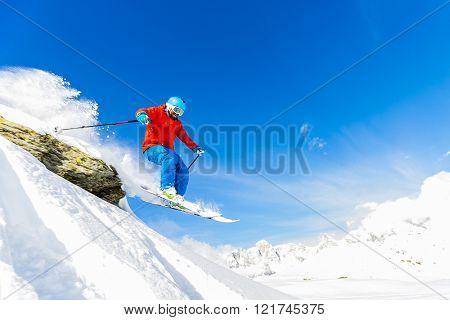 Skiing, Skier, Freeski, Freestyle, Freeride in fresh powder snow