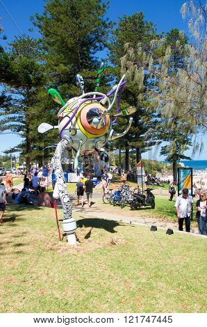 COTTESLOE,WA,AUSTRALIA-MARCH 12,2016: Quirky sculpture on the foreshore with tourists enjoying the interactive arts festival Sculptures By The Sea at Cottesloe Beach in Cottesloe, Western Australia.