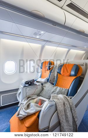 two chairs prepared to sleep in the airplane salon (vertical)