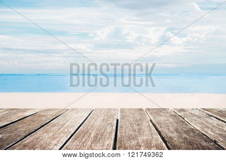 Wooden terrace with the beach view in summer